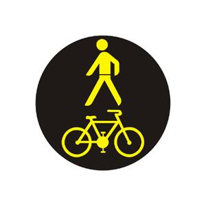 Signál so žltým svetlom v tvare chodca a cyklistu